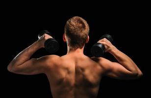 Fitness man with dumbbells