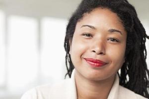 Portrait of smiling businesswoman with dreadlocks, head and shoulders