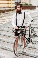 Hipster with bicycle.