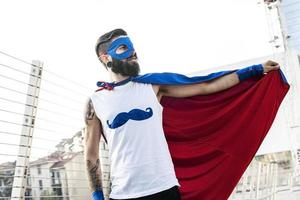 young hipster superhero fights evil photo