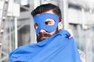 portrait of young hipster superhero photo