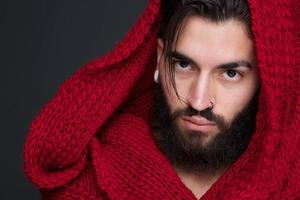 Cool man with beard and red scarf