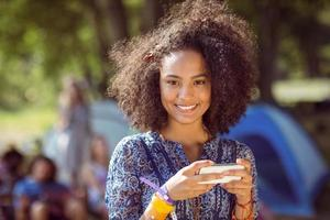 Young, pretty hipster sending text