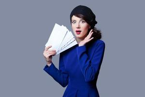 women in blue dress with envelopes