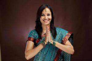 "Smiling young woman greeting ""Namasthe"" photo"