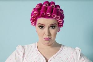 Plus size woman in curlers photo