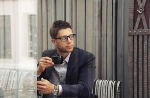 attractive businessman drinking espresso coffee in the city
