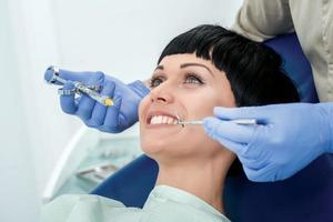 Make happy client the anesthesia. Dentist makes the process