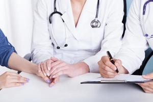 Doctor holding patient's hand photo