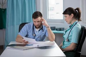 Doctor analsying patient health record photo