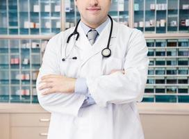 Medical doctor in front of medicine cabinet. hospital clinic.