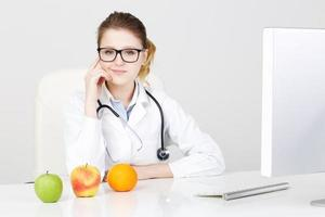 Woman Doctor Recommanding An Apple