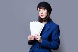 women in blue dress with envelopes photo