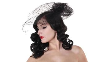 vintage pin up brunette woman with hairstyle photo