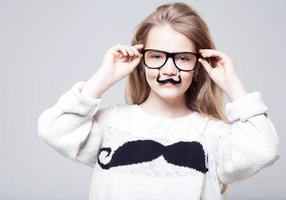 Pretty teenage girl wearing funny eye glasses photo