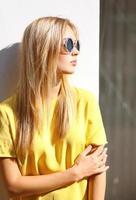 Street fashion photo, stylish pretty hipster girl in sunglasses