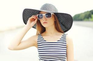 Portrait beautiful young woman wearing a striped dress, black st
