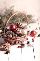 Christmas basket with red and golden ornaments