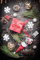 Red Christmas festive gift box with winter and holiday decorations