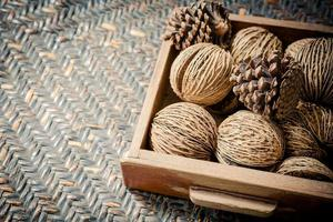 Pine cones in wooden tray