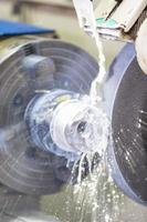 operator grinding forging die parts photo