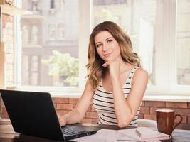 Business woman working on laptop computer at home office