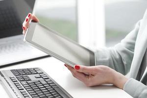 Businesswoman working on digital tablet.