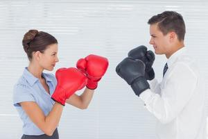 Colleagues in competition having a boxing match photo