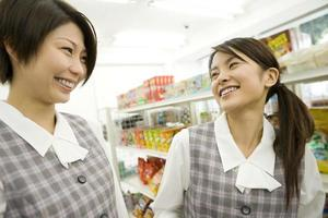 Two women socializing at convenience store