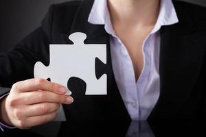 Businessperson With Puzzle