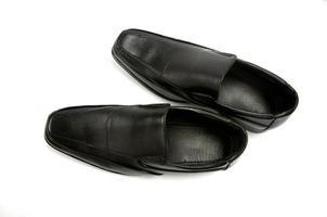Black glossy man shoe isolated on white background