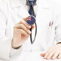 Doctor holding stethoscope with flag series - New Zealand