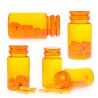 Set of orange pill bottle photo
