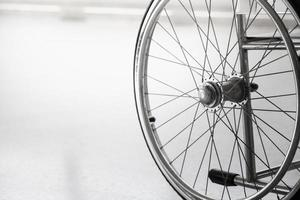 Empty wheelchair parked in hospital hallway photo