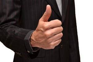 Businessman raising the thumb photo