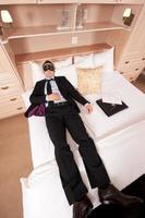 businessman with eye mask photo