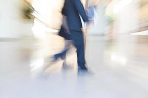 Pedestrians walking, zooming motion blur