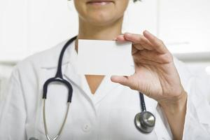 doctor with card