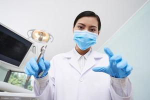 Dentist with pliers photo