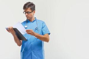 Doctor With Clipboard  Against Grey Background