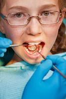 Examination by dentist photo