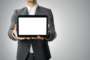 businessman showing blank digital tablet photo