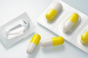 Yellow capsule medicines. photo
