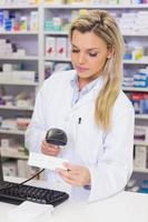 Pharmacist scanning medicines photo