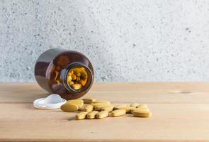 Medicine  on wood background photo