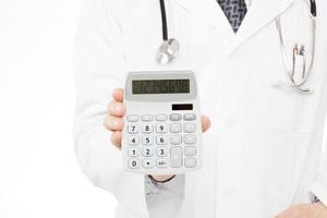 Doctor holding calculator - health care concept