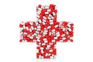 conceito de cuidados de saúde. comprimidos médicos como cruz