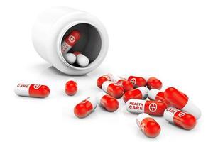 concepto de salud botella médica con pastillas foto