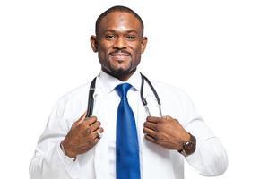 Black doctor portrait isolated on white photo