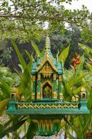 Buddhist altar in the green jungle photo